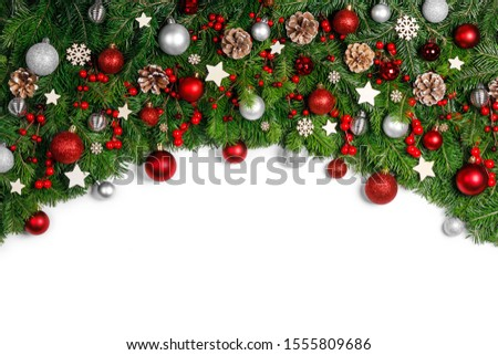 Christmas New year decoration frame isolated on white , fir tree branches , red and silver baubles and pine cones , copy space for text #1555809686
