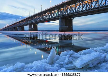 Ice floating on the Amur river. Amur bridge. Trans siberian railway. Khabarovsk, far East, Russia. #1555835879