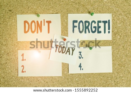 Text sign showing Don T Forget. Conceptual photo used to remind someone about an important fact or detail Corkboard color size paper pin thumbtack tack sheet billboard notice board. #1555892252