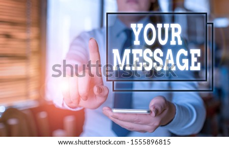 Conceptual hand writing showing Your Message. Business photo text piece of information or a request that you send to someone Woman in the background pointing with finger in empty space. #1555896815