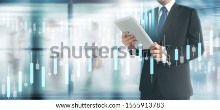 Businessman plan graph growth and increase of chart positive indicators in his business,tablet in hand #1555913783