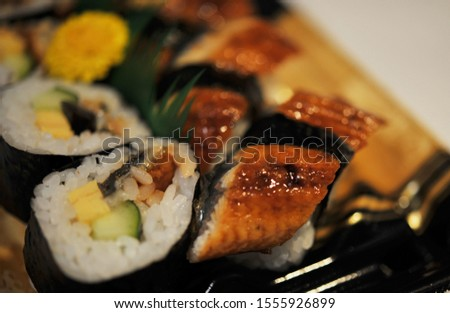 This is eel sushi and rolled sushi #1555926899