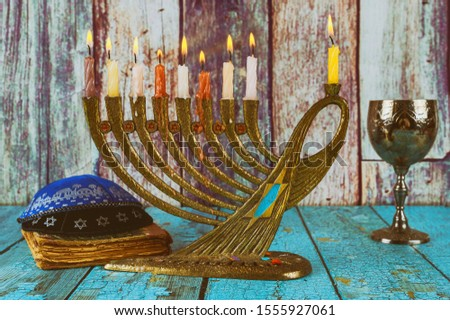 Jewish holiday, Holiday symbol Hanukkah Brightly Glowing Hanukkah Menorah soft focus #1555927061