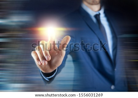business man presses on touch screen #1556031269