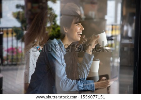 happy hispanic woman, south american latin woman drinking coffee and using smartphone; concept of urban lifestyle in coffee shop with mobile app, smartphone technology, 4G, 5G, internet of things #1556077151