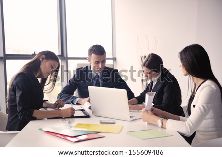 Group of happy young  business people in a meeting at office #155609486