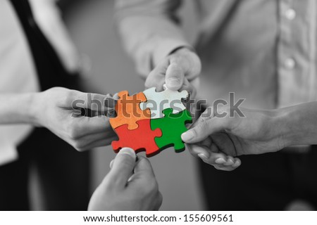 Group of business people assembling jigsaw puzzle and represent team support and help concept Royalty-Free Stock Photo #155609561