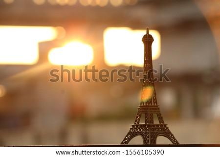 eiffle tower model in golden hour #1556105390
