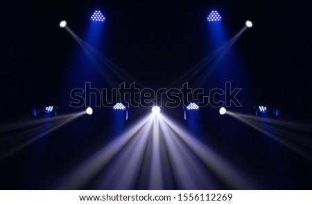 Theater lights spotlights over the stage, texture background for design. #1556112269