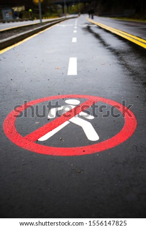 This sign indicates that pedestrians are forbidden to walk on this road. #1556147825