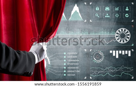 Hand opening red curtain and drawing business graphs and diagrams behind it #1556191859