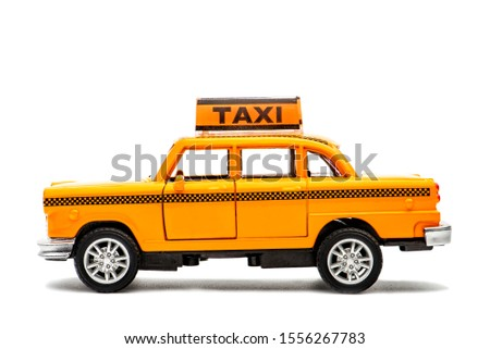 toy - yellow taxi car model. isolated on white background. yellow taxi car. idea, symbol, concept of urban service #1556267783