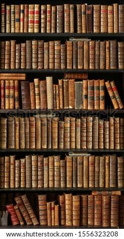 old books on wooden shelf #1556323208
