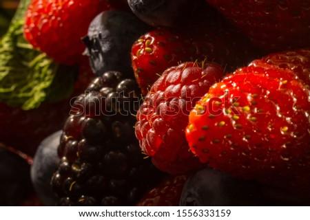 Juicy berries, strawberries, blackberries, blueberries, raspberries in macro mode. Berry background. Berry texture. #1556333159