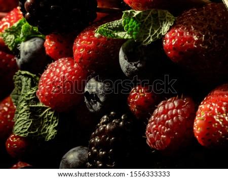 Juicy berries, strawberries, blackberries, blueberries, raspberries in macro mode. Berry background. Berry texture. #1556333333