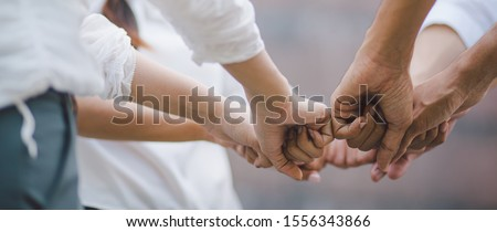 Panoramic teamwork business join hand together concept, Business team standing hands together, Volunteer charity work. People joining for cooperation success business. #1556343866