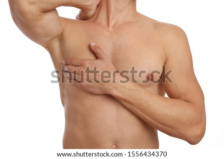 Muscular male torso, chest and armpit hair removal. Male Waxing. Male laser epilation. Royalty-Free Stock Photo #1556434370