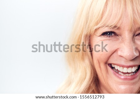 Cropped Studio Shot Of Laughing Mature Woman Against White Background At Camera #1556512793