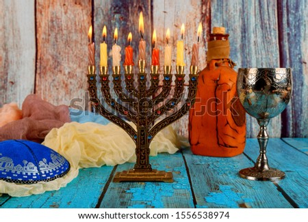 Jewish holiday, Holiday symbol Hanukkah Brightly Glowing Hanukkah Menorah soft focus #1556538974
