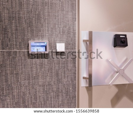 Security woman in uniform standing infront of safe door with keypad and touchscreen #1556639858
