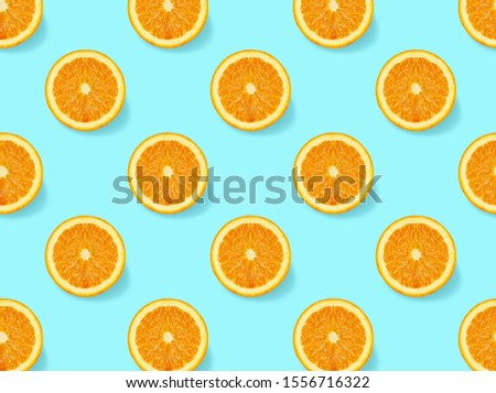 Pattern with oranges slices on blue  background. Creative  seamless background. Isometric view. #1556716322