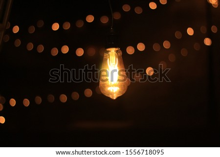 Lighting decor. vintage edison light bulb close up bokeh background design #1556718095