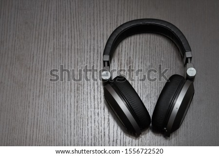 big headphones on the table Royalty-Free Stock Photo #1556722520