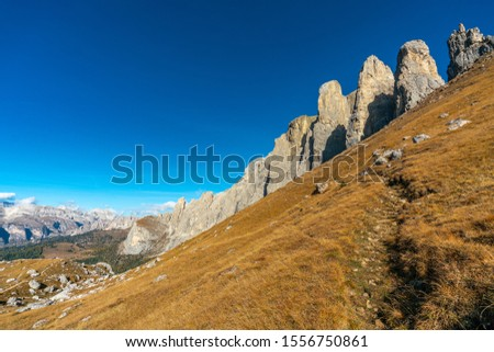 Beautiful panorama view of the Sellastock massif in the italian Dolomites mountains on a very sunny autumn day with dark blue skies #1556750861