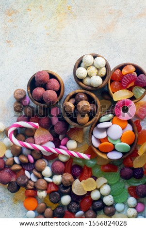 colorful bright assorted sweets and candy for kids party on white table, assortment of many candies  #1556824028