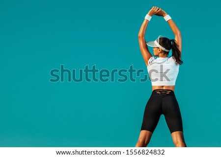 Sporty and fit young woman athlete doing yoga training on the sky background. The concept of a healthy lifestyle and sport. Individual sports recreation. #1556824832