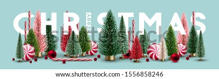 Christmas web headline with Christmas trees and candies. Elements for Christmas design. Royalty-Free Stock Photo #1556858246