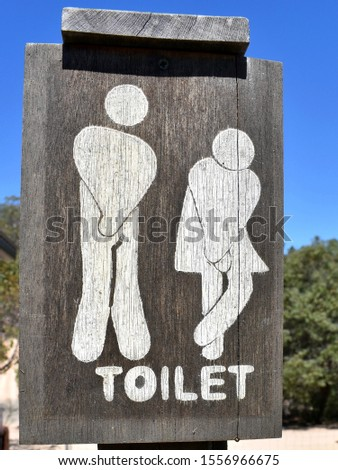 An interesting depiction of a man and a women on a toilet sign