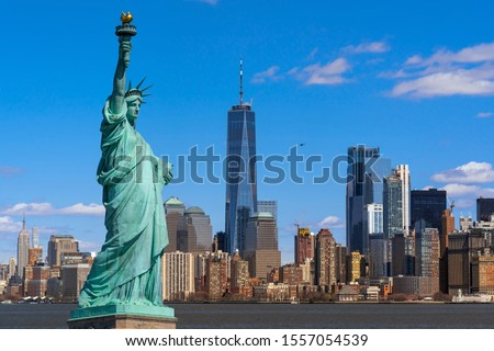 The Statue of Liberty over the Scene of New york cityscape river side which location is lower manhattan,Architecture and building with tourist concept #1557054539