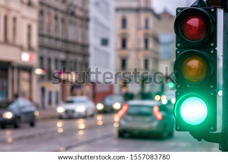 A city crossing with a semaphore. Green light in semaphore - image #1557083780