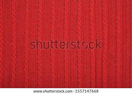 Knitted background. Knitted red texture. A knitting pattern of wool. Knitting. Background. #1557147668