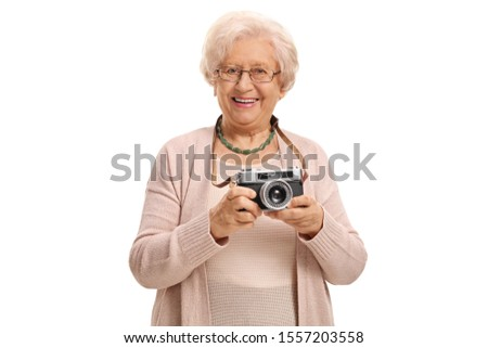 Elderly lady with a vintage camera isolated on white background