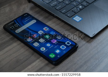 """Jakarta, Indonesia - November 12, 2019: The Vivo Z1 Pro Android smartphone is built around a 6.53"""" FHD+ display. #1557229958"""