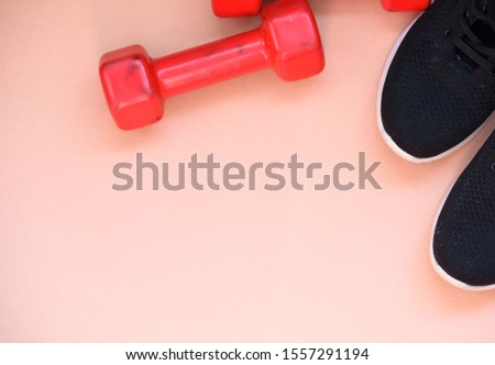 Black sneakers with red dumbbells. Sport equipment. Sport content. #1557291194