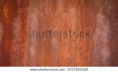 Rusty metal background with streaks of rust. Rust stains. Rysty corrosion. rust on old metal background #1557345560