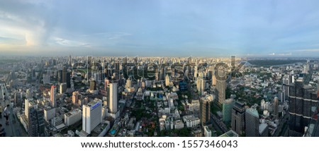 Bangkok, Thailand - June 8 2019: Panoramic view of Bangkok, Skyline at Sunset #1557346043
