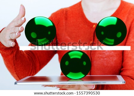 Woman balances on tablet pc a balance with balls #1557390530