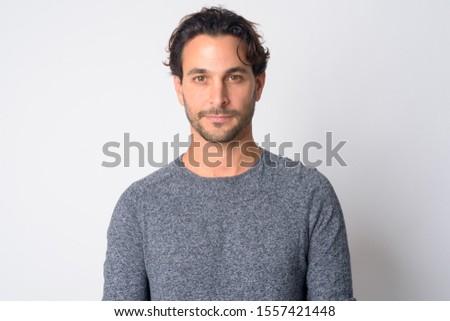 Face of handsome Hispanic man looking at camera #1557421448
