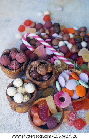 colorful bright assorted sweets and candy for kids party on white table, assortment of many candies  #1557427928