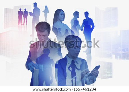 Happy successful diverse business team working with gadgets in abstract city. Concept of international partnership and business lifestyle. Toned image double exposure #1557461234