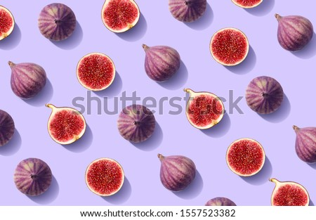 Colorful fruit pattern of fresh figs on purple pastel background, top view, flat lay #1557523382