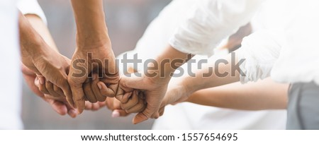 Panoramic teamwork business join hand together concept, Business team standing hands together, Volunteer charity work. People joining for cooperation success in antivirus protection. Royalty-Free Stock Photo #1557654695