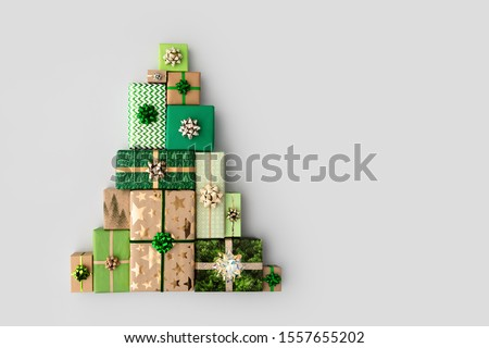 Christmas gift boxes laid out in the shape of a Christmas tree, overhead view Royalty-Free Stock Photo #1557655202