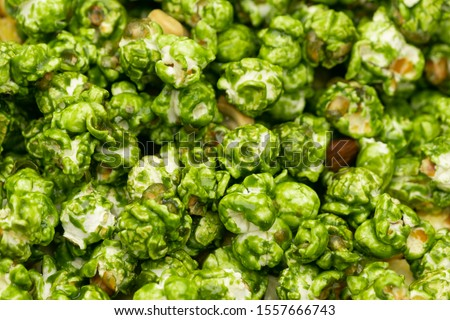 Lush of Japanese matcha green tea popcorn for texture background, Popular snack with favorite movie #1557666743