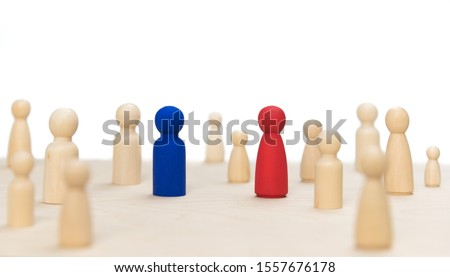systemic board for family therapy. Wooden figures posing as people, a team or a family constellation Royalty-Free Stock Photo #1557676178