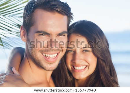 Cheerful loving couple on the beach having holidays #155779940